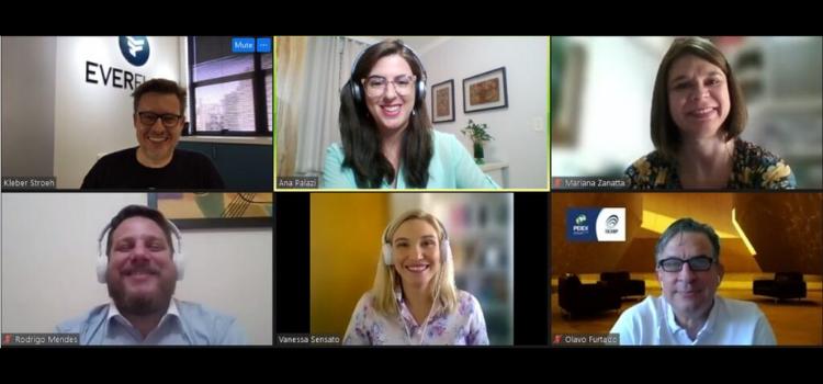 Painel com seis telas onde aparecem os palestrantes e a equipe da Inova Unicamp